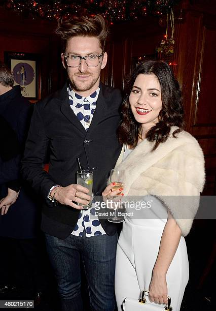 Henry Holland and Marina Diamandis attend the Sunday Times Style Xmas Party at Tramp on December 9 2014 in London England