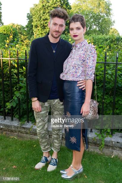 Henry Holland and Pixie Geldof attend a private view of 'Fashion Rules' a new exhibition featuring a rare collection of dresses worn by Queen...
