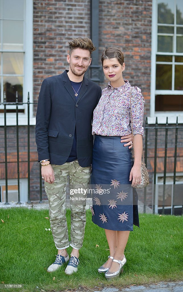 Henry Holland and Pixie Geldof attends the launch party for the Fashion Rules exhibition, a collection of dresses worn by HRH Queen Elizabeth II, Princess Margaret and Diana, Princess of Wales at Kensington Palace on July 4, 2013 in London, England.
