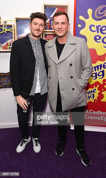 Henry Holland and Scott Mills attend the launch of the Cadbury Creme Egg Cafe in Soho on January 21 2016 in London England