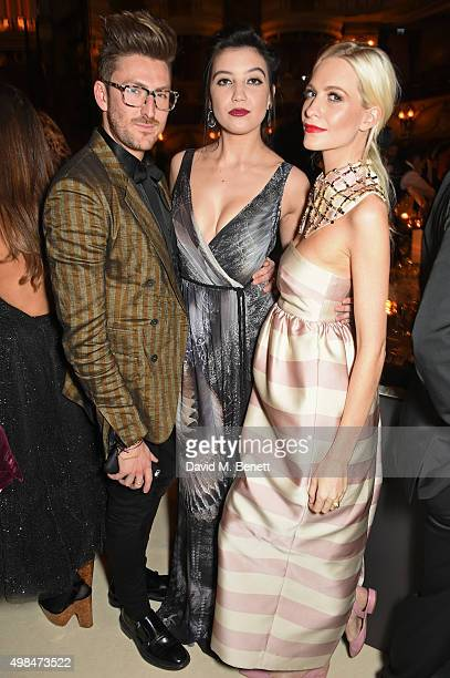 Henry Holland Daisy Lowe and Poppy Delevingne attend a drinks reception at the British Fashion Awards in partnership with Swarovski at the London...
