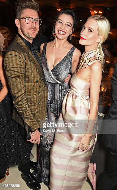 Henry Holland, Daisy Lowe and Poppy Delevingne attend a drinks reception at the British Fashion Awards in partnership with Swarovski at the London...