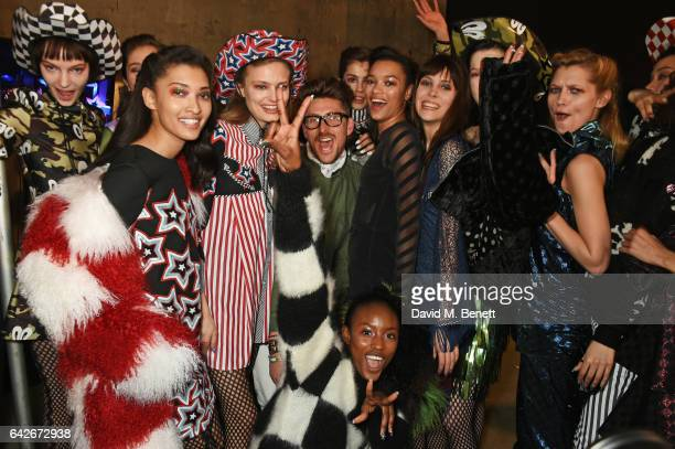 Henry Holland poses with models backstage at the House of Holland show during the London Fashion Week February 2017 collections on February 18 2017...