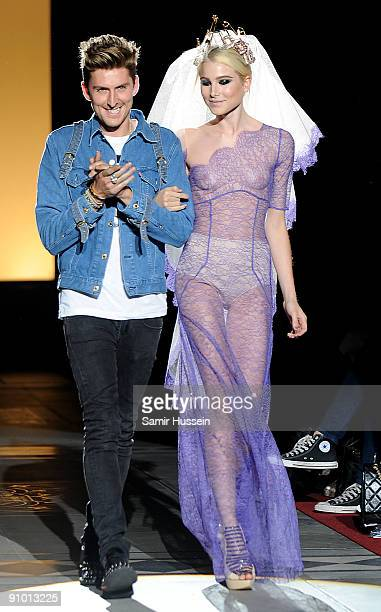 Henry Holland walks the catwalk with a model at the House of Holland fashion show at the Guildhall during London Fashion Week on September 21 2009 in...