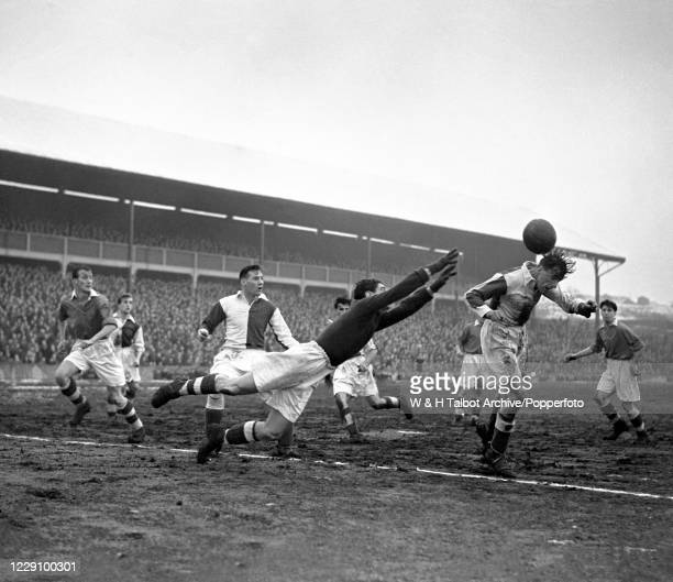 Henry Horton of Blackburn Rovers heads the ball in front of Queens Park Rangers goalkeeper Reg Allen during a Football League Division Two match at...