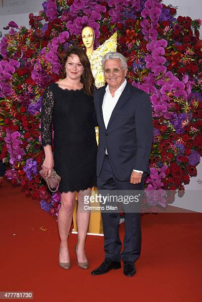 Henry Huebchen and guest arrive for the German Film Award 2015 Lola at Messe Berlin on June 19 2015 in Berlin Germany