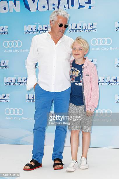 Henry Huebchen and his grandson Lenn attend the 'Ice Age Kollision Voraus' German Premiere at CineStar on June 26 2016 in Berlin Germany