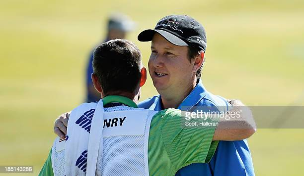 J Henry hugs his caddie Don Donatello on the ninth green after finishing with an 11under par 60 during the first round of the Shriners Hospitals for...