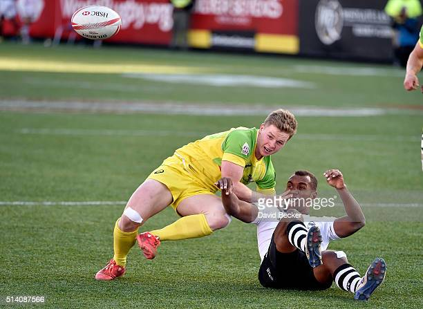 Henry Hutchison of Australia and Osea Kolinisau of Fiji watch a loose ball during the Cup Final at the USA Sevens Rugby tournament at Sam Boyd...