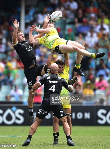Henry Hutchison of Australia competes with Scott Curry of New Zealand at the restart during the mens pool match between New Zealand and Australia in...
