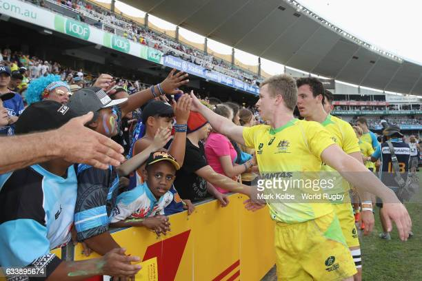 Henry Hutchison of Australia high fives the crowd after the bronze medal match between Australia and New Zealand in the 2017 HSBC Sydney Sevens at...