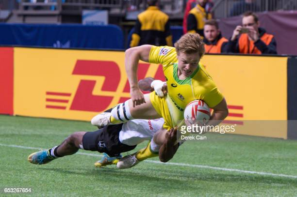 Henry Hutchison of Australia is tackled by Jerry Tuwai of Fiji during day 2 of the 2017 Canada Sevens Rugby Tournament on March 12 2017 in Vancouver...