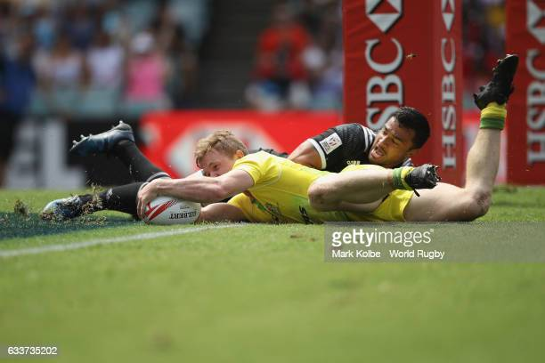 Henry Hutchison of Australia scores a try during the Men Pool C match between Australia and New Zealand in the 2017 HSBC Sydney Sevens at Allianz...