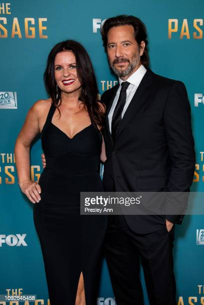 Henry Ian Cusick Annie Cusick attend FOX's 'The Passage' Premiere Party at The Broad Stage on January 10 2019 in Santa Monica California