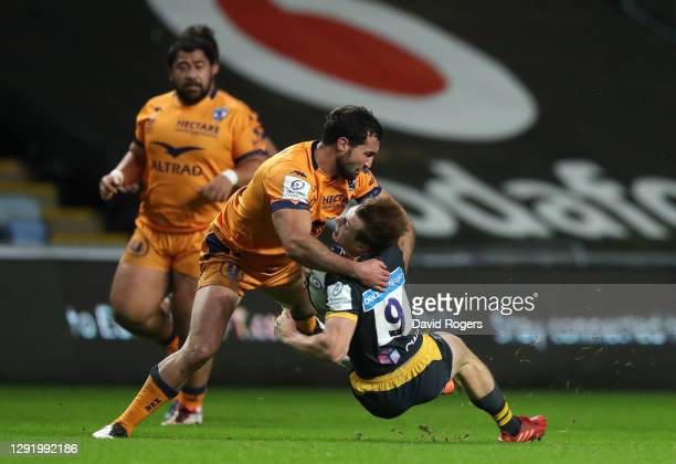 Henry Immelman of Montpellier makes a tackle on Will Porter of Wasps which leads to his sending off during the Heineken Champions Cup Pool 1 match...