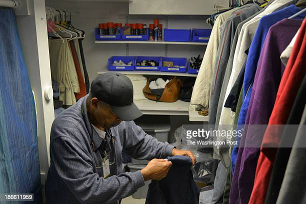 Henry Jones, a shower monitor at the homeless shelter Christ House, sorts through donated clothes, some of which were discarded by runners during the...