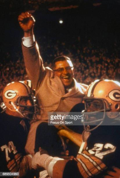 Henry Jordan and Willie Davis of the Green Bay Packers carries off head coach Vince Lombardi after they defeated the Kansas City Chiefs in Super Bowl...