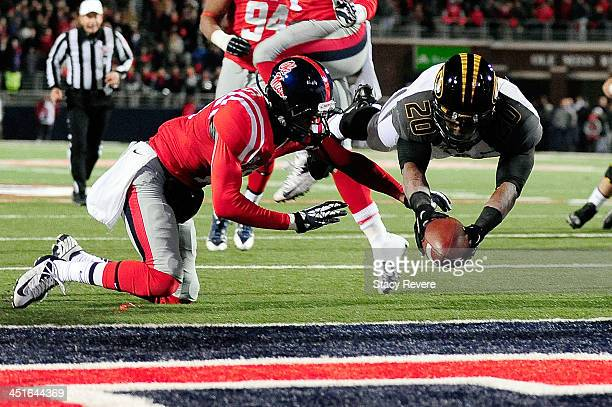 Henry Josey of the Missouri Tigers dives for a touchdown in front of Mike Marry of the Ole Miss Rebels during a game at Vaught-Hemingway Stadium on...