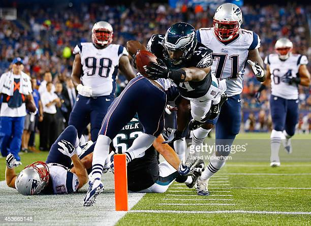 Henry Josey of the Philadelphia Eagles dives in for a touchdown in the third quarter against the New England Patriots during the preseason game at...