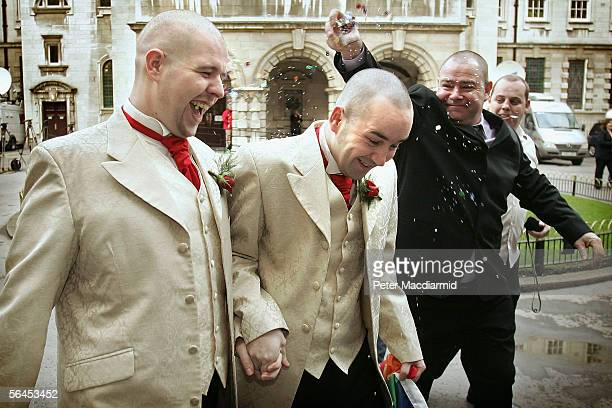 Henry Kane and Christopher Flanagan laugh as confetti is thrown at them after they becoming the United Kingdom's second gay couple to marry in a...
