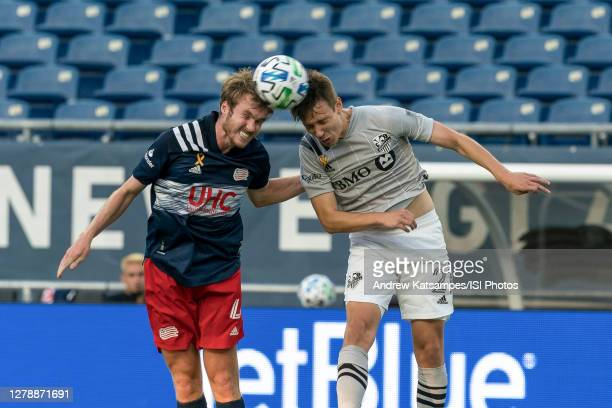 Henry Kessler of New England Revolution and Lassi Lappalainen of Montreal Impact battle for head ball during a game between Montreal Impact and New...