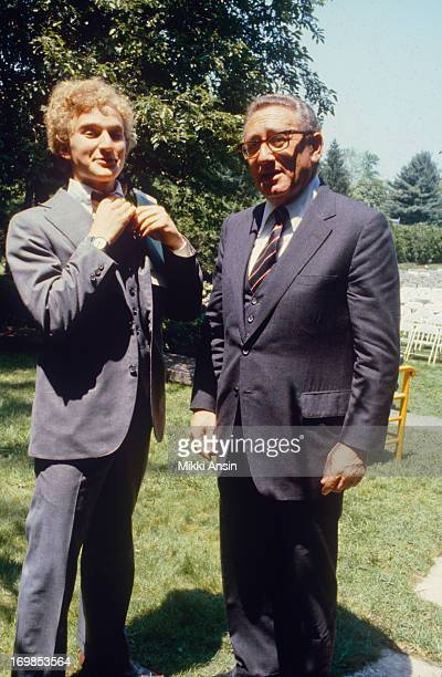 Henry Kissinger adjusts tie of son David Kissinger at his graduation from Concord Academy Massachusetts 1st June 1979