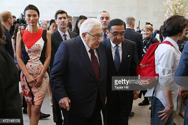 Henry Kissinger and Silas Chou attend the 'China Through the Looking Glass' press preview at the Temple of Dendur at Metropolitan Museum of Art on...