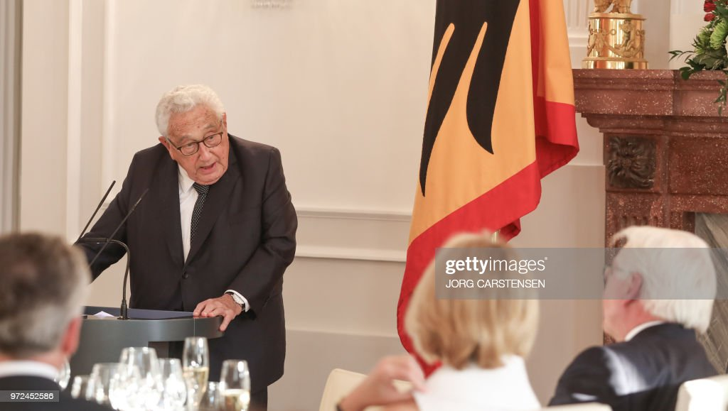 Henry Kissinger (R) delivers a speech at the presidential Bellevue Palace in Berlin on June 12, 2018, where he is received by German President Frank-Walter Steinmeier (R) on the occasion of Kissinger's 95th birthday. (Photo by Jörg Carstensen / dpa / AFP) / Germany OUT