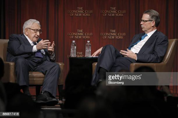 Henry Kissinger, left, former U.S. Secretary of state, speaks with Glenn Hutchins, co-founder of Silver Lake Credit Fund LP, during an Economic Club...