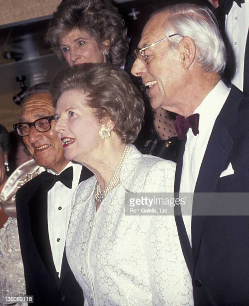 Henry Kissinger Margaret Thatcher and husband Denis Thatcher attend Royal Princess Dinner Gala on August 7 1991 at Pier 88 in New York City