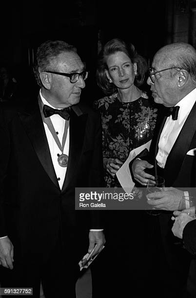 Henry Kissinger Nancy Kissinger and Ahmet Ertegun attend A Decade of Literary Lions Benefit Gala on November 8 1990 at the New York Public Library in...