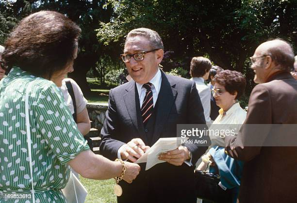 Henry Kissinger socializes with the crowd at Concord Academy graduation of son David Kissinger Concord Massachusetts 1st June 1979