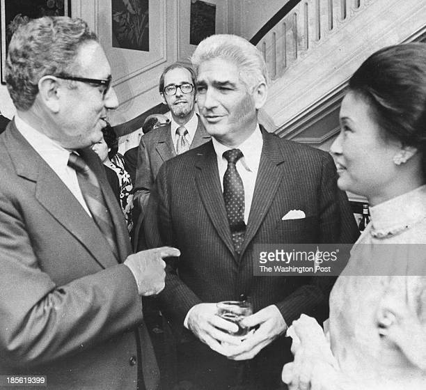 FILE Henry Kissinger talks with William H Sullivan center and Mrs Tran Kim Phuong wife of the South Vietnamese ambassador at the National Day...