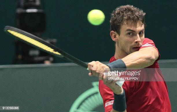 Henry Laaksonen of Switzerland returns a ball to Dmitry Popko of Kazakhstan during their Davis Cup Final match in Astana Kazakhstan on February 2...