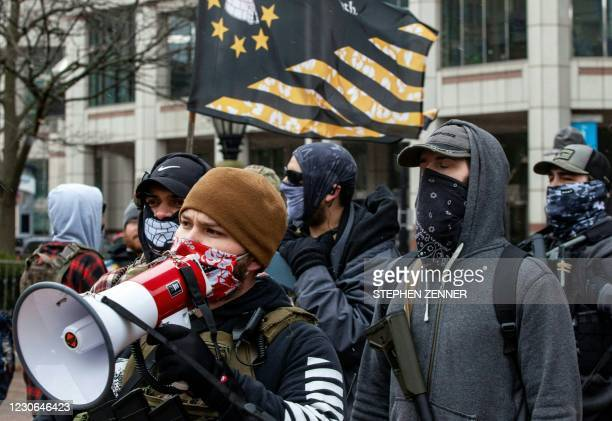 Henry Locke, of the Ohio Boogaloo movement, talks to the media near the Ohio Statehouse in Columbus, Ohio January 17, 2021 during a nationwide...