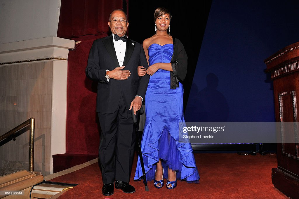 Henry Louis Gates Jr. is escorted onstage by Khyara Harris at the The Jackie Robinson Foundation Annual Awards' Dinner at the Waldorf Astoria Hotel on March 4, 2013 in New York City.