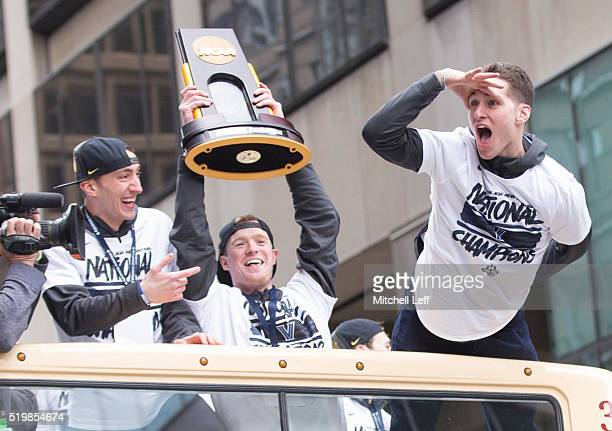 Henry Lowe Patrick Farrell and Ryan Arcidiacono of the Villanova Wildcats celebrate during the Villanova Wildcats Championship Parade on April 8 2016...