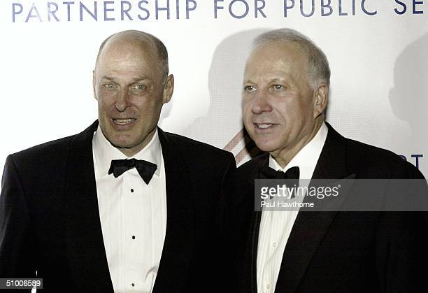 Henry M Paulson Jr Chairman and Chief Executive Officer The Goldman Sachs Group Inc Samuel J Heyman Chairman of International Specialty Products pose...
