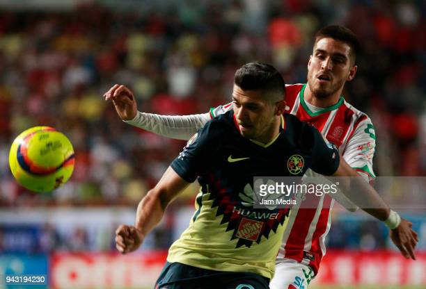Henry Martin of America and Igor Lichnovsky of Necaxa during the 14th round match between Necaxa and America as part of the Torneo Clausura 2018 Liga...