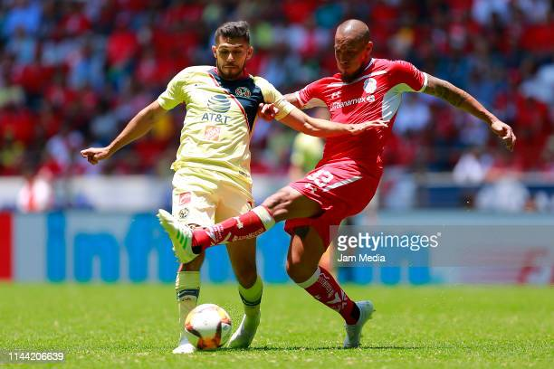 Henry Martin of America and Jonatan Maidana of Toluca fight for the ball during the 15th round match between Toluca and America as part of the Torneo...