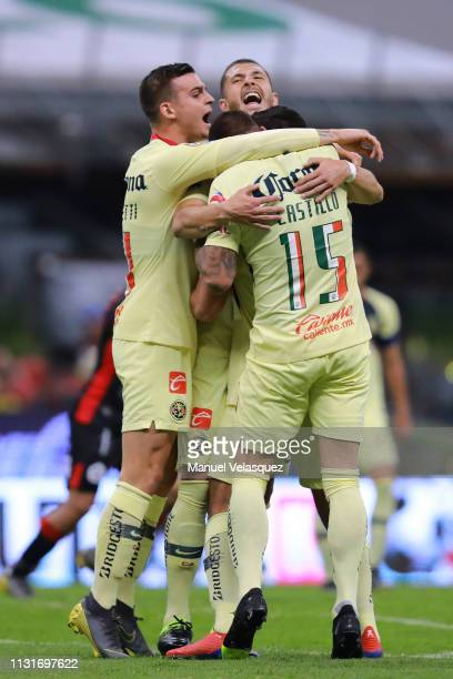 Henry Martin of America celebrates a after scoring the opening goal with his teammates during the 8th round match between America and Lobos BUAP as...