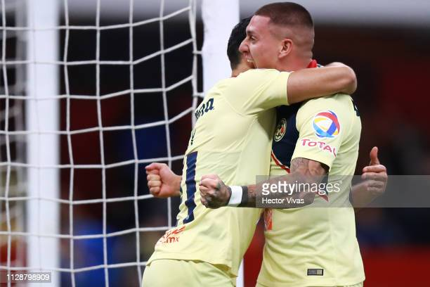 Henry Martin of America celebrates with Nicolas Castillo of America after scoring the first goal of his team during a first round match between...