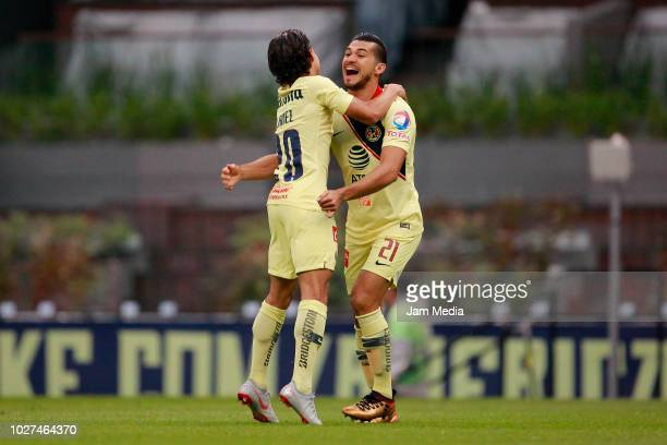 Henry Martin of America celebrates with teammate after scoring the first goal of his team during a Group G match between America and Dorados as part...