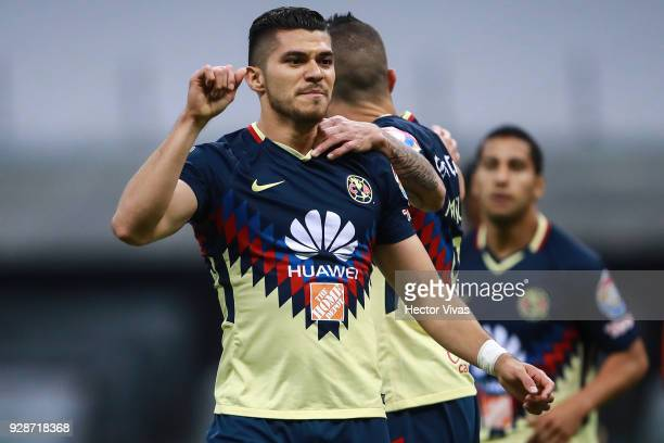 Henry Martin of America celebrates with teammate Mateus Uribe after scoring the second goal of his team during the match between America and Tauro FC...