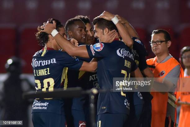 Henry Martin of America celebrates with teammates after scoring the first goal of his team during a match between Veracruz and Club America as part...