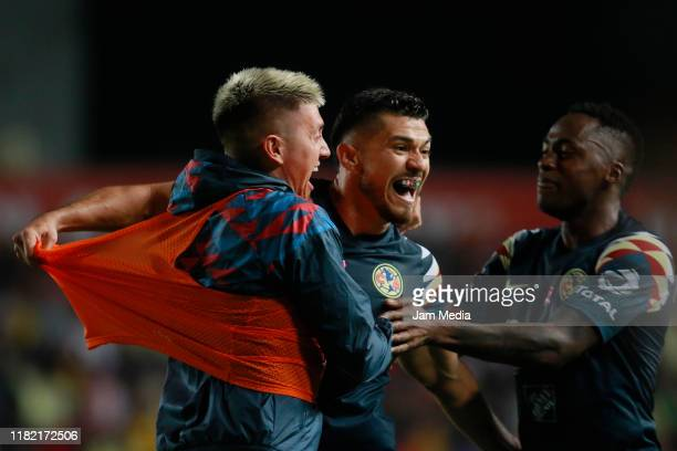 Henry Martin of America celebrates with teammates after scoring the second goal of his team during the 14th round match between Necaxa and America as...