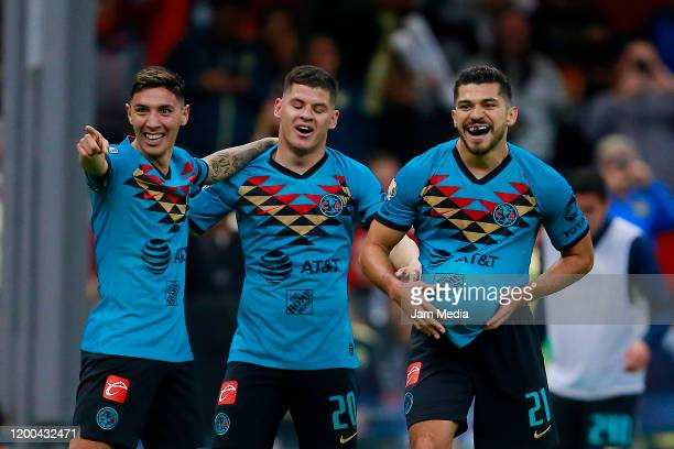 Henry Martin of America celebrates with teammates after scoring the first goal of his team during the 2nd round match between America and Tigres UANL...