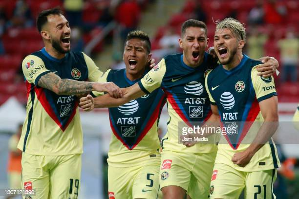 Henry Martin of America celebrates with teammates after scoring the second goal of his team during the 11th round match between Chivas and America as...