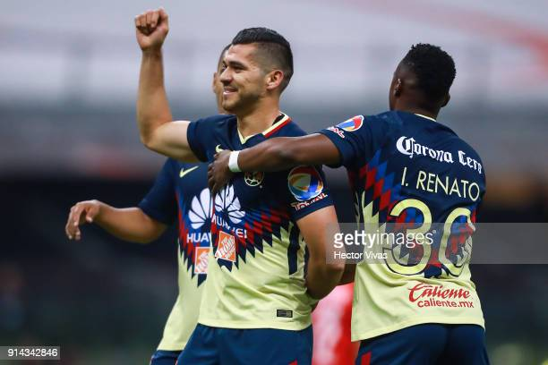Henry Martin of America celebrates with teammates after scoring the first goal of his team during the 5th round match between America and Lobos BUAP...