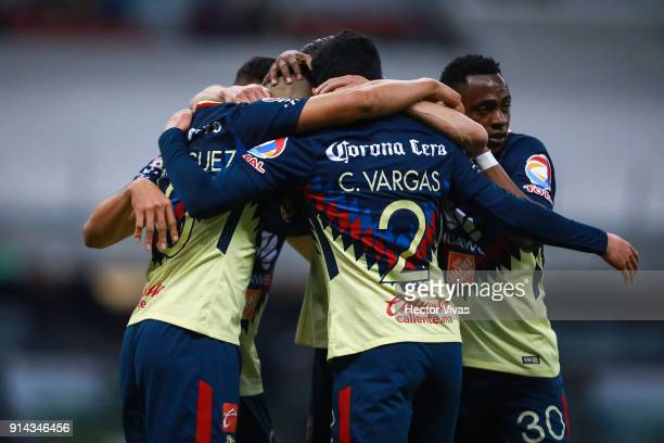 Henry Martin of America celebrates with teammates after scoring the second goal of his team during the 5th round match between America and Lobos BUAP...